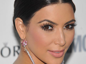 Kim K rocking her signature tightliner look, not to mention those curled lashes!
